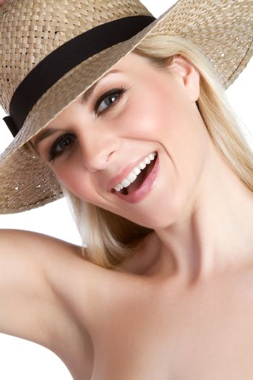 Beautiful smiling woman wearing hat