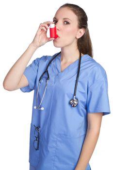 Pretty nurse using asthma inhaler