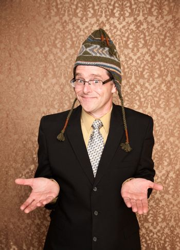 Funny Businessman in Knit Cap Shrugging