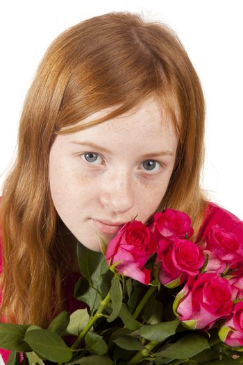 Little girl is holding pink roses