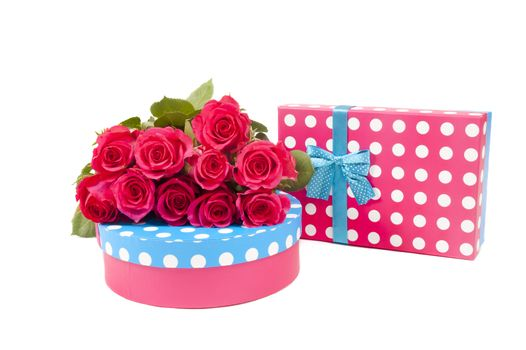 two giftboxes with pink roses isolated on white