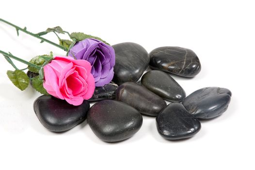 little stones with roses on top of it