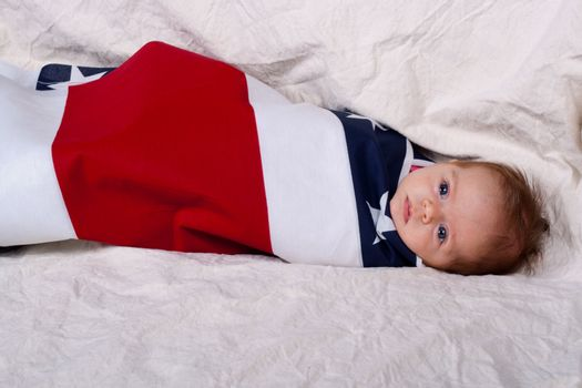 This adorable baby represents 4th of July/ Independence day and the protection that America gives all babies that are born in the United States.