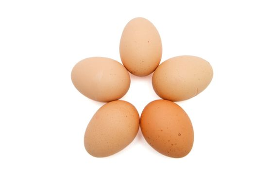 Five-pointed star of five brown eggs isolated