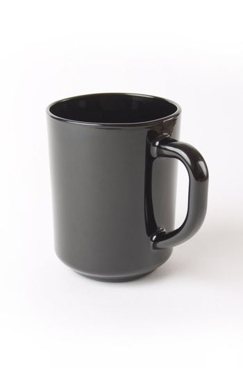 black ceramic cup of coffee and tea