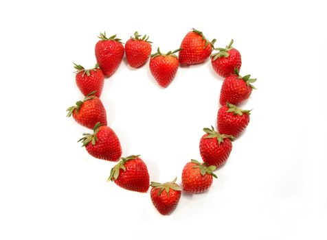 Strawberries shaped to form a heart on white