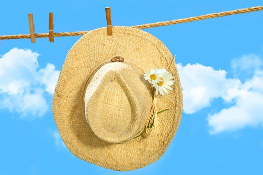 Straw hat on clothesline