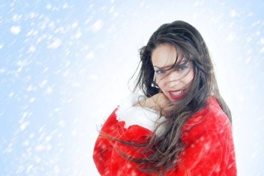 Smiling lady in the red Santa Claus costume on a white and blue background with falling snowflakes