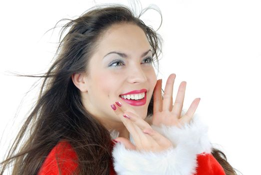 Smiling happy lady with blown hairs in a furry Santa Claus dress on a white background
