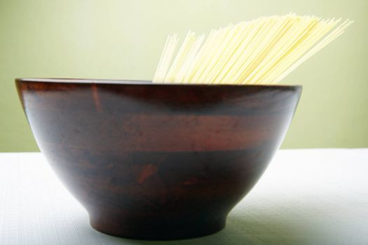 Close-up photo of the Italian pasta in the brown cup. Depth of field added by the macro lens for natural view