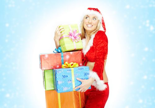 Happy lady in the red Santa Claus costume holding gift boxes on a white and blue background with snow