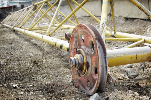 Close-up horizontal photo of the heavy industry machinery. Metal wheelbase. Natural colors and light