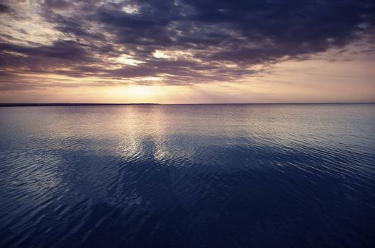 Sunset at the sea. Horizontal photo with natural light and darkness