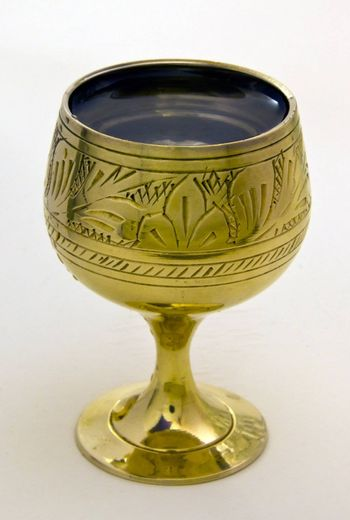 dishy full  beautiful wine-cup with alcohol