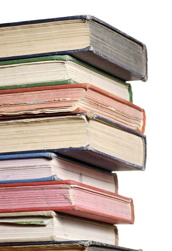 a close up stack of books isolated against white