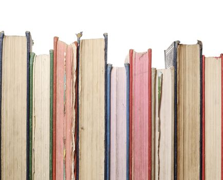 a close up row of books isolated against white