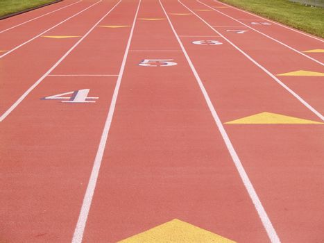 numbered lanes on an outdoor running track