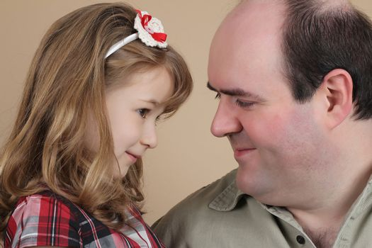 Portrait of a beautiful girl and her father