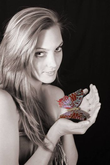 Beautiful young female model with large butterfly