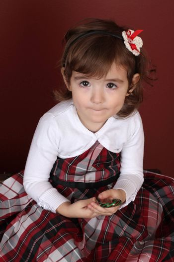Cute little brunette toddler with serious expression