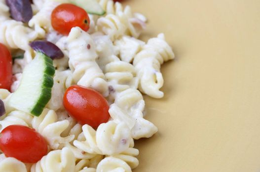 Cold Pasta Salad with tomatoes, cucumbers and olives
