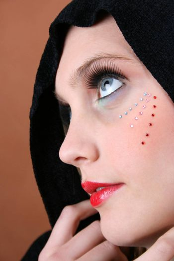 Female model with blue eyes wearing a scarf