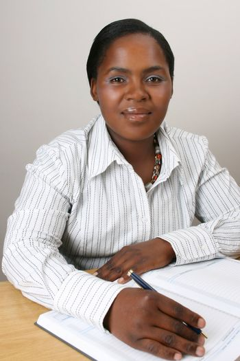 Business Woman with a pen in hand on diary