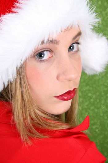 Teenager with red lips wearing a christmas hat