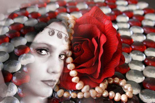 Female model withwearing folk dress layered with pebbles and jewelery