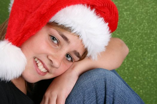 Beautiful teenager girl wearing a christmas hat