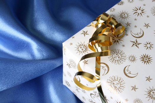 Wrapped Christmas present with a golden ribbon