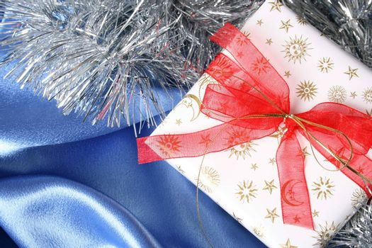 Wrapped christmas gifts with tinsel and bow
