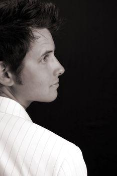 Male model in studio against black background
