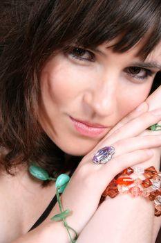 Female model with intense eyes wearing beautiful jewelery