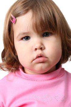 Beautiful brunette toddler wearing a pink top