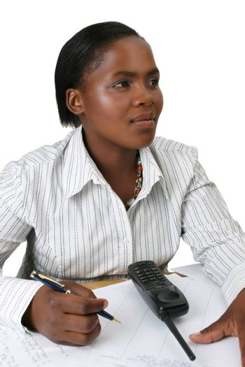 Business woman in thought holding a pen in her hand