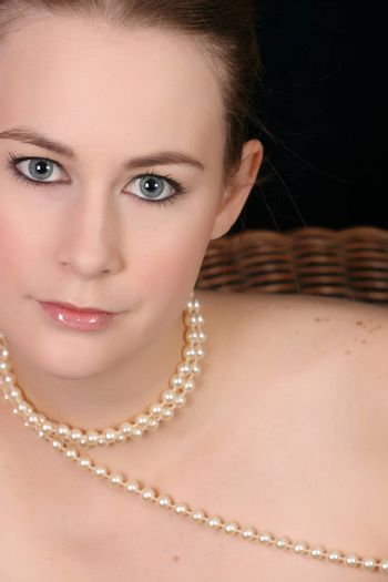 Close up of beautiful female wearing pearls