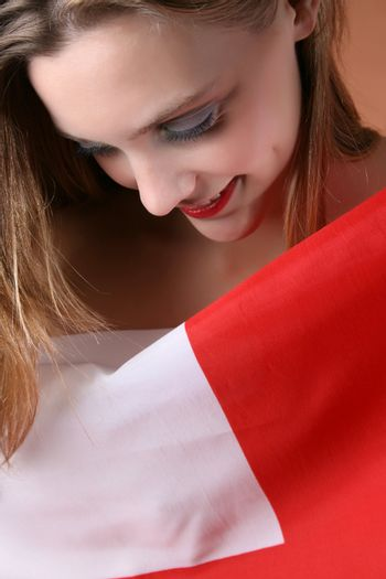 Young blond model covered by the English Flag