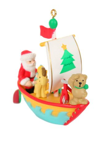 Teddy bear and father christmas in a boat christmas decoration