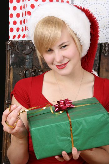 Beautiful blond female holding a christmas present