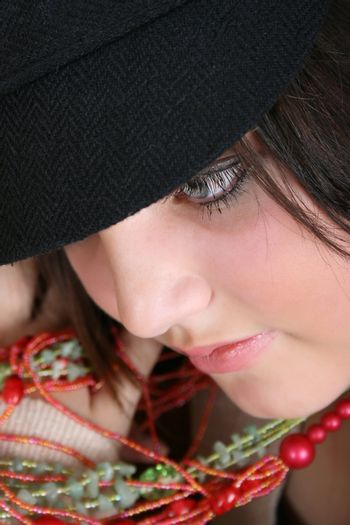 Close-up of a beautiful brunette teen wearing a hat