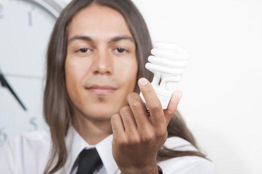 Man with energy efficient lightbulb