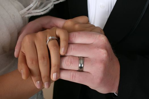 Bride and groom holding hands on their wedding day