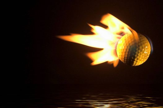 A flaming golf ball flying over a water hazard.