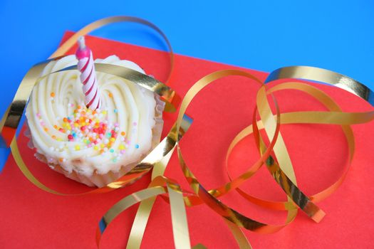 Birthday Cupcake with one candle and gold ribbon