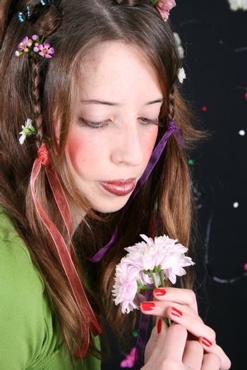 Teenage model with flowers and butterflies in her hair