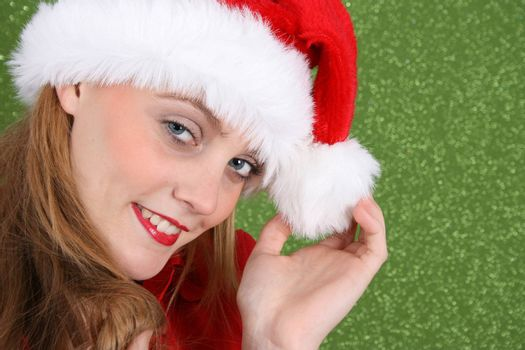 Female Model with red lips wearing a christmas hat