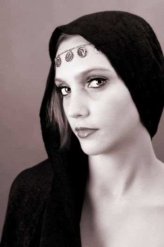 Female model with blue eyes wearing traditional folk dress