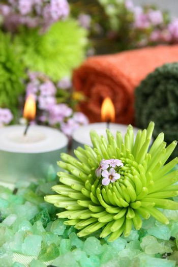 Spa Accessories setting with face cloths, candles and flowers