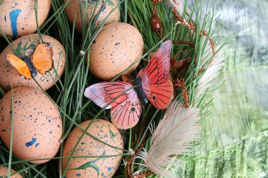 Decorated eggs in a wreath on a green background